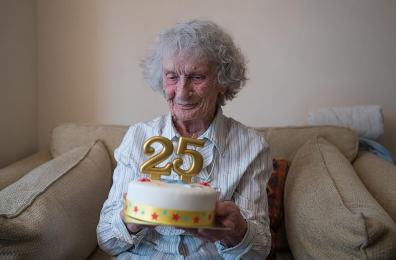 Great-great grandmother Doris Cleife holds a birthday cake with candles showing the number 25, in her flat at Housing 21's Brunel Court in Portsmouth, as she prepares to turn 100 years old on 29th February, though it is only the 25th time Doris has been able to celebrate her birthday due to being born during a leap year.