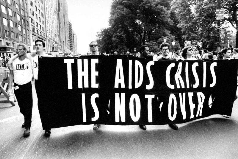 Gay ACT UP members carrying huge banner that reads THE AIDS CRISIS IS NOT OVER as they walk down the street during Gay & Lesbian Pride march. (Photo by Michael Abramson/The LIFE Images Collection via Getty Images/Getty Images)