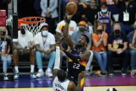 Phoenix Suns center Deandre Ayton, right, shoot over Los Angeles Clippers guard Paul George, left, during the first half of Game 1 of the NBA basketball Western Conference finals Sunday, June 20, 2021, in Phoenix. (AP Photo/Ross D. Franklin)