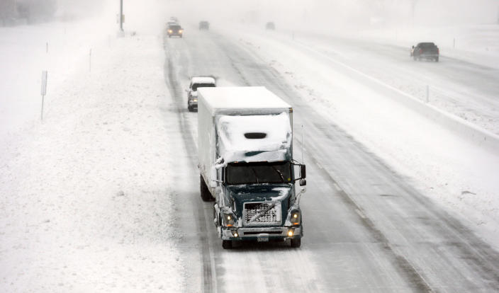 A truck makes its way down a snow covered Interstate I-35/I-80, Thursday, Dec. 20, 2012, in Des Moines, Iowa. The first widespread snowstorm of the season began a slow crawl across the Midwest on Thursday with some areas receiving as much as 15 inches of snow. (AP Photo/Charlie Neibergall)