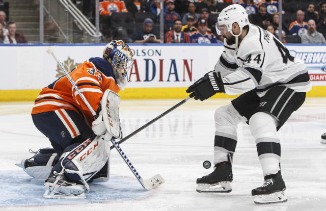 Los Angeles Kings' Nate Thompson (44) is stopped by Edmonton Oilers' goalie Cam Talbot (33) during the third period of an NHL hockey game Saturday, March 24, 2018, in Edmonton, Alberta. (Jason Franson/The Canadian Press via AP)