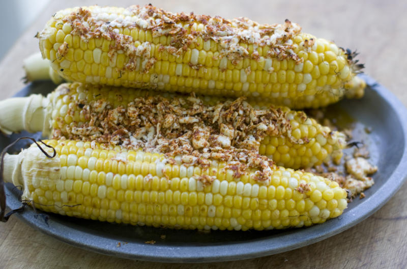 This July 15, 2013 photo shows grilled corn with queso fresco in Concord, N.H. (AP Photo/Matthew Mead)