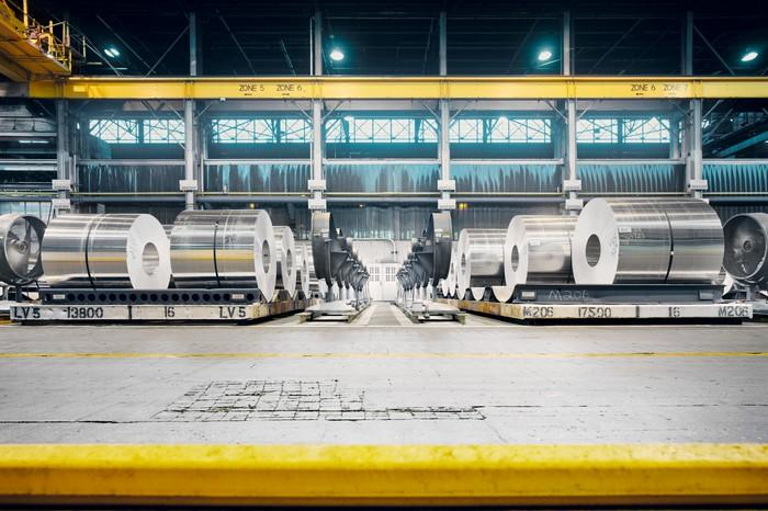aluminum coils rolled up at a manufacturing facility.