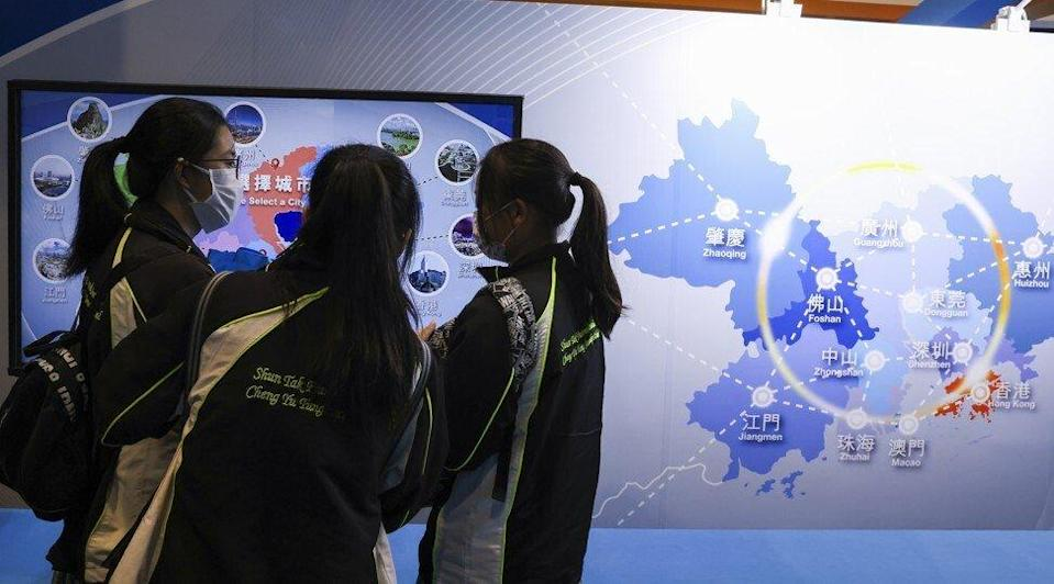 Students visit a booth set up by the Guangdong-Hong Kong-Macau Greater Bay Area Development Office at the Hong Kong Convention and Exhibition Centre in Wan Chai on July 15, 2021. Photo: Nora Tam