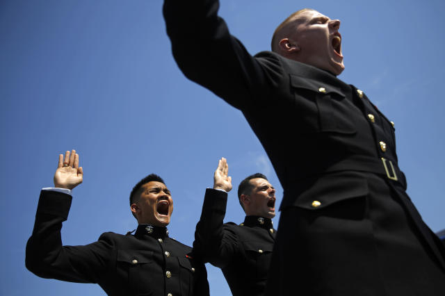 <p>U.S. Naval Academy midshipmen raise their right hands as they are commissioned as second lieutenants in the U.S. Marine Corp during the Academy's graduation and commissioning ceremony, Friday, May 25, 2018, in Annapolis, Md. (Photo: Patrick Semansky/AP) </p>