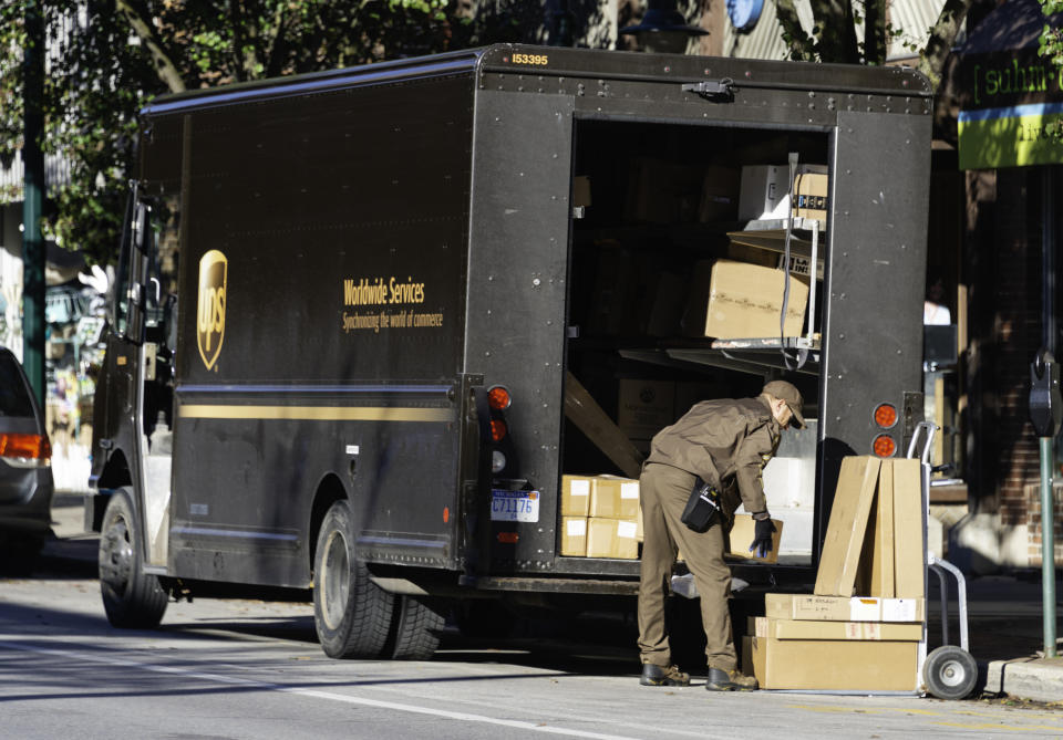 A UPS driver making deliveries in downtown Traverse City, Michigan. (Photo: Getty)