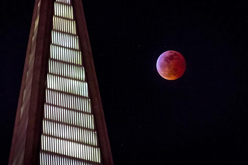 The super blood wolf moon rises behind the Transamerica Pyramid in San Francisco, Jan. 20.