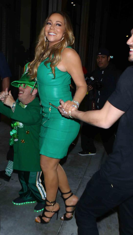 "<p>What, did you expect the diva to put on a onesie? Carey wore a green version of her usual fancy dress, as she <a rel=""nofollow"" href=""http://www.etonline.com/news/213232_mariah_carey_celebrates_st_patricks_day_with_bryan_tanaka_and_kids"">partied</a> with men dressed as leprechauns on St. Patrick's Day 2017. (Photo: Splash News) </p>"
