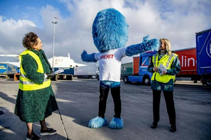 """The """"Brexit Monster"""" posed for the media at the port of Rotterdam while customs officials handed out """"Get ready"""" flyers to lorry drivers."""