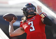 FILE - In this Saturday, Oct. 24, 2020 file photo, Texas Tech's Henry Colombi (3) during an NCAA college football game against West Virginia in Lubbock, Texas. Kansas State and Texas Tech changed starting quarterbacks midseason for much different reasons. While true freshman quarterbacks are now starting for the two Big 12 teams in the Sunflower State of Kansas, and No. 18 Oklahoma is led by redshirt freshman Spencer Rattler, the senior seasons for Sam Ehlinger at No. 21 Texas and Charlie Brewer at Baylor don't necessarily have to be the end of their college careers. (AP Photo/Brad Tollefson, File)
