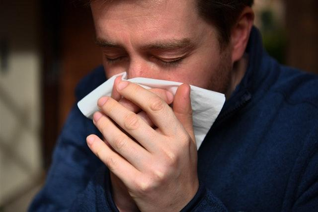 The virus is spread through cough or sneeze droplets, so make sure you catch them in a tissue you then throw away