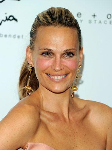 "The Key: Pink Blush-<br />If you want an effect that's more fresh-faced than tawny, try a look like Molly Sims'sâ€""it's all about the blush. Piling pink onto the apples of your cheeks will brighten up your complexion in two seconds flat. <br> <b>Related: <a rel=""nofollow"" href=""http://www.cosmopolitan.com/hairstyles-beauty/skin-care-makeup/bright-makeup-looks-0110?link=emb&dom=yah_life&src=syn&con=blog_cosmo&mag=cos"">Unforgettable Makeup Looks To Try</a></b>"