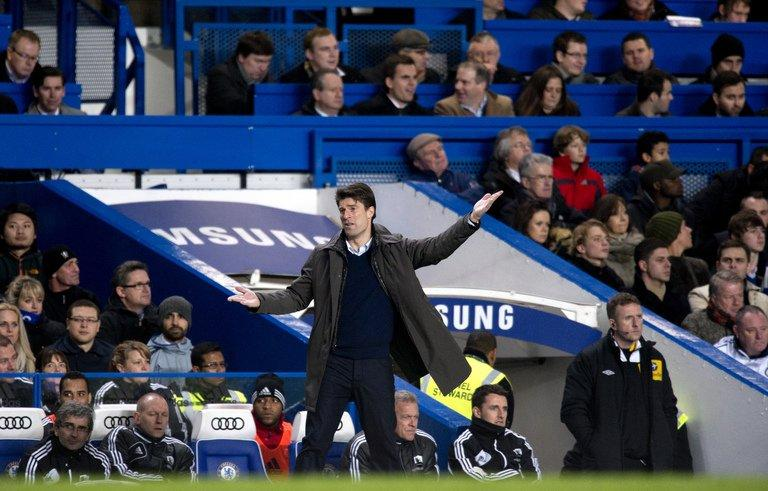 Swansea City's Danish manager Michael Laudrup gestures during the League Cup semi-final at Chelsea on January 9, 2013. Swansea won the first-leg match 2-0. But Laudrup refused to accept his side were favourites to go through and play either fourth-tier Bradford or Premier League rivals Aston Villa