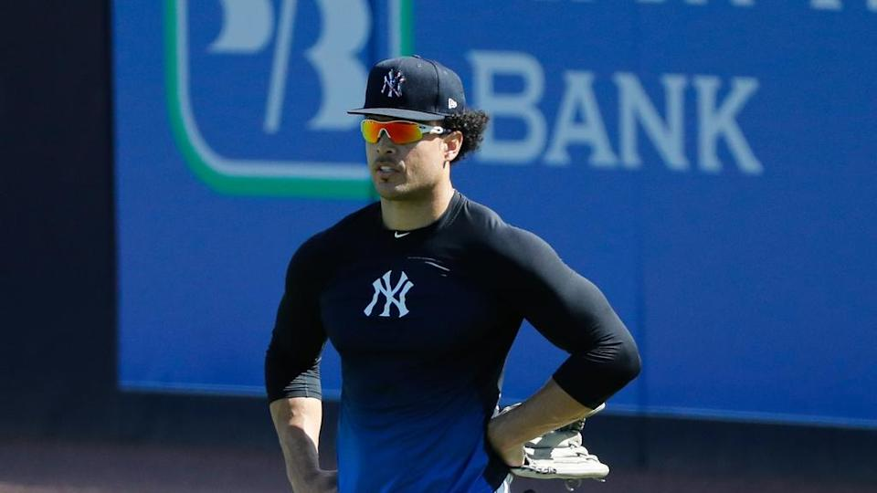 Giancarlo Stanton stands waiting in outfield during spring training