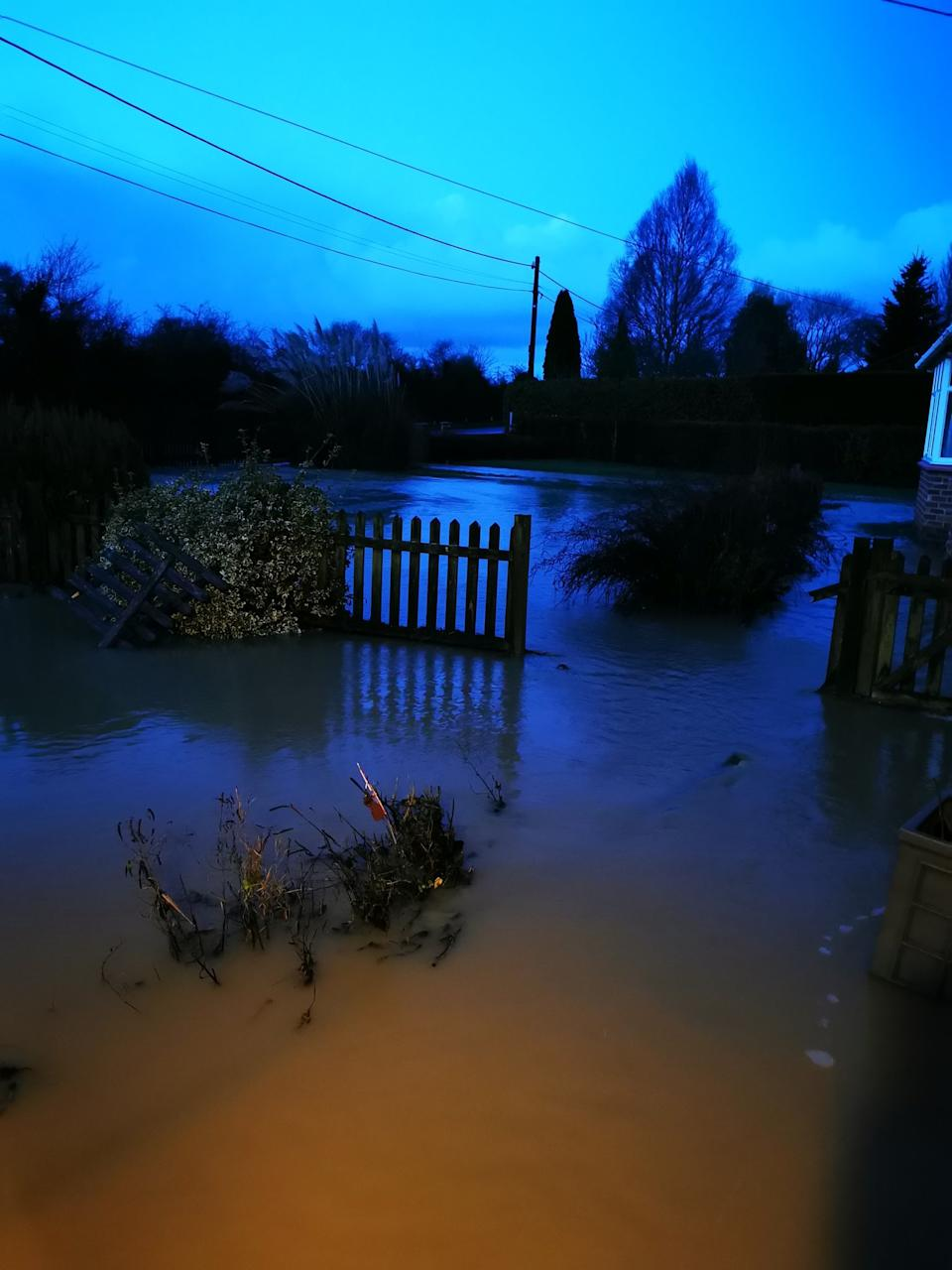 Handout photo courtesy of Peter Lloyd of flooding at his home in Peterborough, Cambridgeshire after heavy rain overnight.