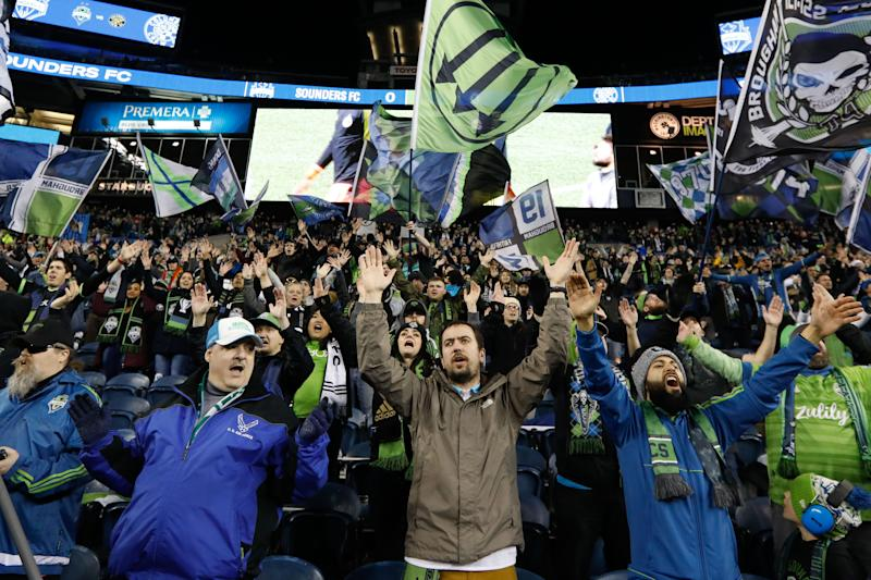 Mar 7, 2020; Seattle, Washington, USA; Seattle Sounders FC fans cheer before a game against the Columbus Crew at CenturyLink Field. Mandatory Credit: Jennifer Buchanan-USA TODAY Sports