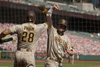 San Diego Padres' Wil Myers is greeted by teammate Tommy Pham (28) after hitting a home run off San Francisco Giants starting pitcher Drew Smyly in the second inning of a baseball game Sunday, Sept. 27, 2020, in San Francisco. (AP Photo/Eric Risberg)