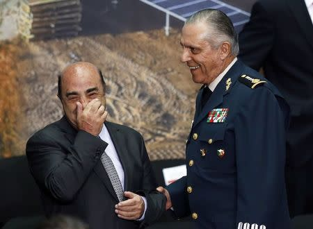 Mexico's attorney general Jesus Murillo Karam (L) and Mexico's Defense Minister General Salvador Cienfuegos share a smile during a meeting at the National Palace in Mexico City August 11, 2014. REUTERS/Edgard Garrido