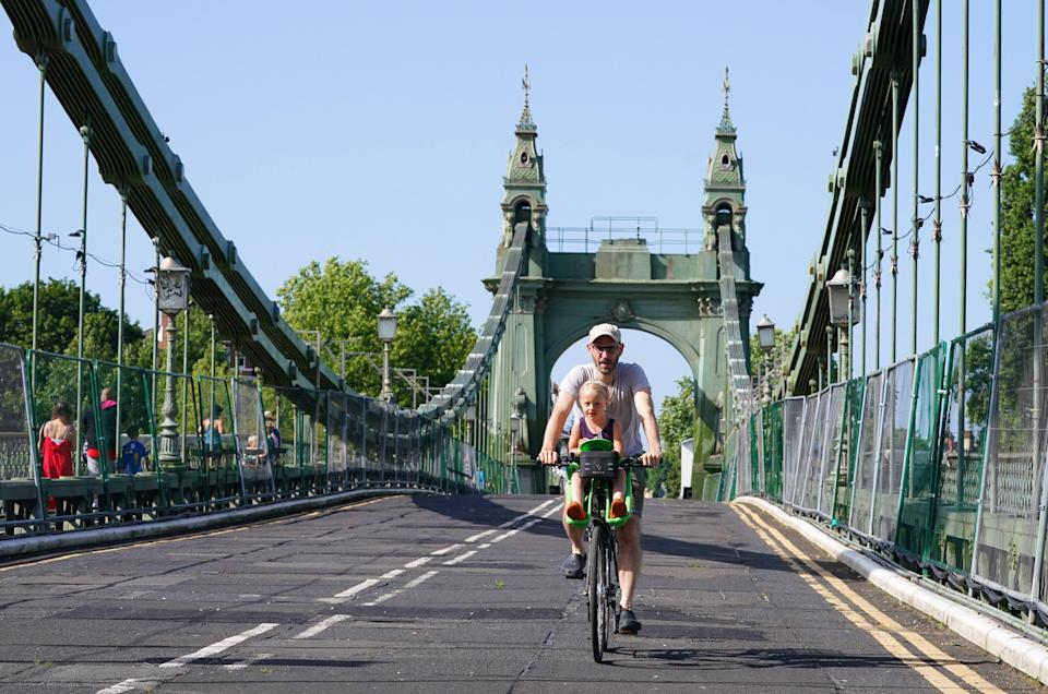It was perfect weather as Hammersmith Bridge in London reopened to pedestrians and cyclists for the first time after a long closure on safety grounds (Jonathan Brady/PA) (PA Wire)