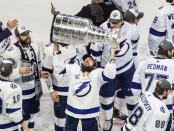 FILE - In this Sept. 28, 2020, file photo, Tampa Bay Lightning's Nikita Kucherov (86) hoists the Stanley Cup after defeating the Dallas Stars in the NHL Stanley Cup hockey finals, in Edmonton, Alberta. The Stanley Cup Finals between Tampa Bay and Montreal begins Monday, June 28, 2021, in Tampa, Fla. (Jason Franson/The Canadian Press via AP, File)