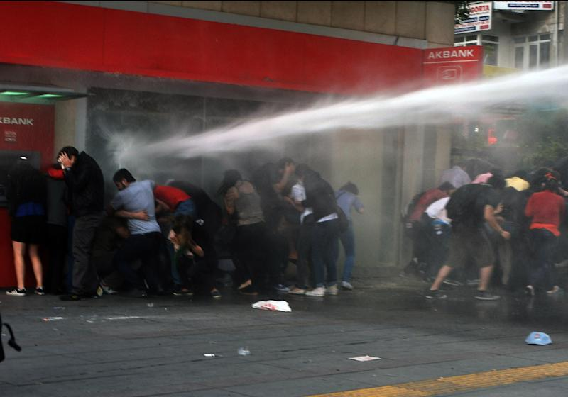 Riot police use water cannon to disperse protesters in Turkish capital, Ankara, late Wednesday, June 5, 2013. In Ankara and Istanbul, thousands of union members asked Turkey's prime minister Recep Tayyip Erdogan to resign.(AP Photo)