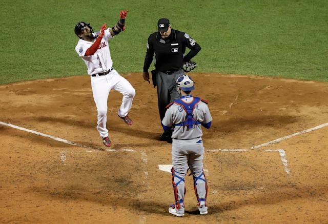 Boston Red Sox's Eduardo Nunez reacts after hitting a three-run home run during the seventh inning of Game 1 of the World Series baseball game against the Los Angeles Dodgers Tuesday, Oct. 23, 2018, in Boston. (AP Photo/David J. Phillip)