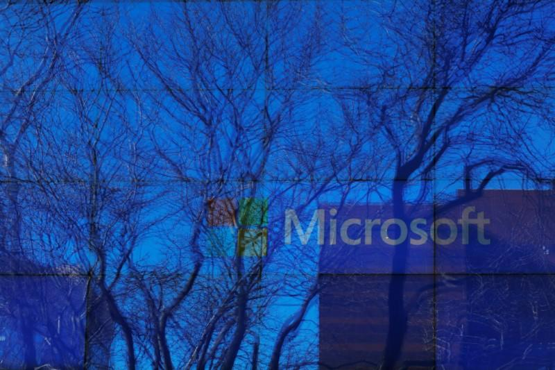An advertisement is played on a set of large screens at the Microsoft office in Cambridge