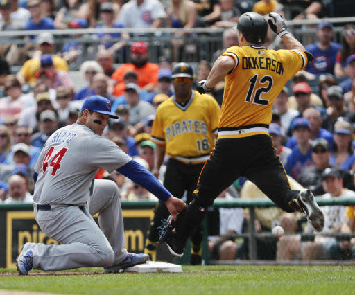 Pittsburgh Pirates' Corey Dickerson (12) beats the throw to Chicago Cubs first baseman Anthony Rizzo as he reaches first on a bunt single, and went to second on the throwing error ion the first inning of a baseball game, Sunday, Aug. 19, 2018, in Pittsburgh. (AP Photo/Keith Srakocic)