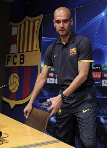 Barcelona's coach Josep Guardiola arrives to give a press conference at the Camp Nou stadium in Barcelona, on the eve of their Champions League semi-final second leg match against Chelsea