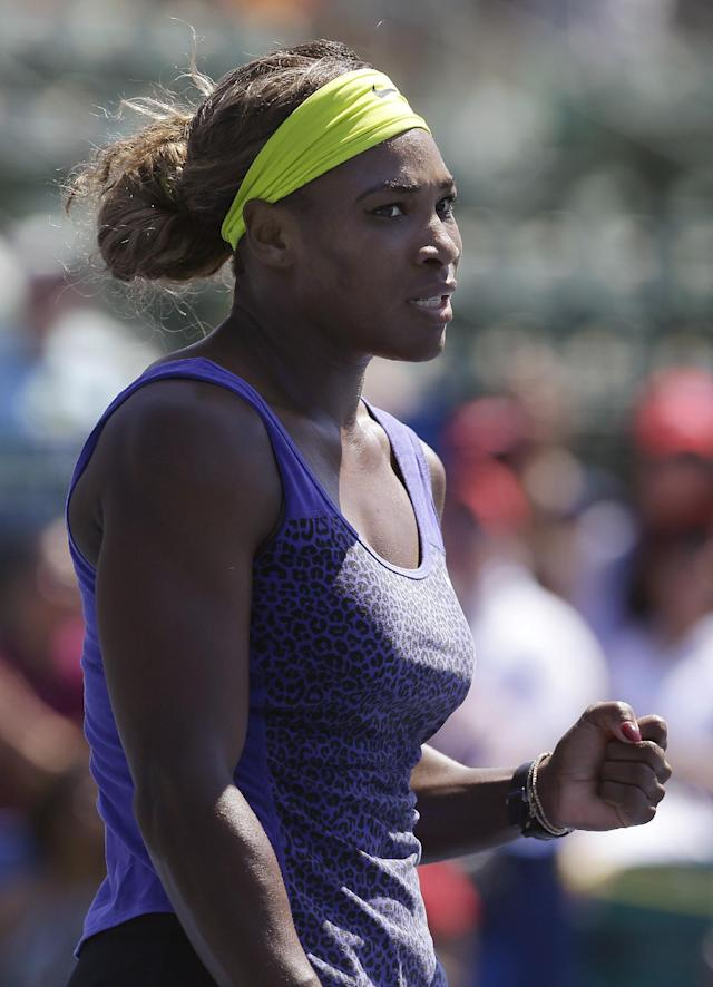 Serena Williams, of the United States, reacts after winning a point against Andrea Petkovic, from Germany, during the second set of their semifinal in the Bank of the West Classic tennis tournament in Stanford, Calif., Saturday, Aug. 2, 2014. Williams won 7-5, 6-0. (AP Photo/Jeff Chiu)