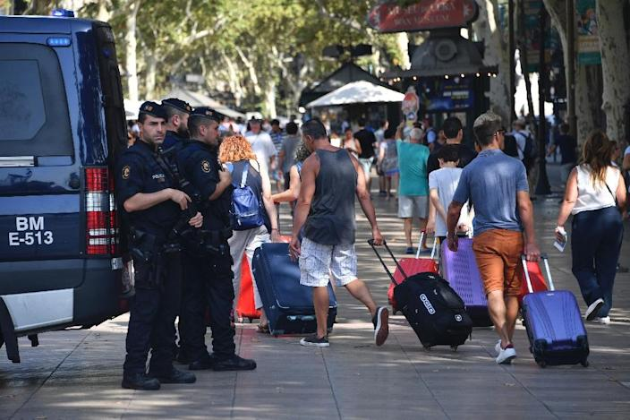 Security has been tightened after the van rampage on Barcelona's popular Las Ramblas boulevard (AFP Photo/Pascal GUYOT)