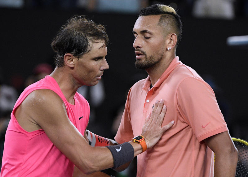 Spain's Rafael Nadal, left, is congratulated by Australia's Nick Kyrgios after winning their fourth round singles match at the Australian Open tennis championship in Melbourne, Australia, Monday, Jan. 27, 2020. (AP Photo/Andy Brownbill)