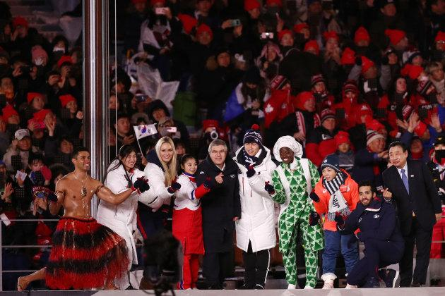 President of the International Olympic Committee Thomas Bach and Lee Hee-beom, President & CEO of Pyeongchang Organizing Committee stand on the stage with Lindsey Vonn of the U.S, Pita Taufatofua of Tonga and other Olympic athletes during the closing ceremony of the Pyeongchang 2018 Winter Olympic Games at Pyeongchang Olympic Stadium on Feb. 25, 2018.