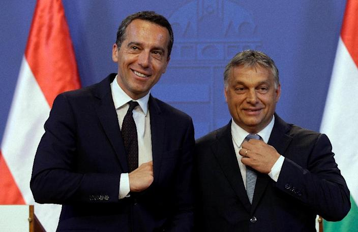 Austrian Chancellor Christian Kern (L) and Hungarian Prime Minister Viktor Orban (R) in Budapest, on July 26, 2016 (AFP Photo/Peter Kohalmi)