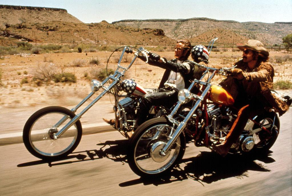 """<a href=""""http://movies.yahoo.com/movie/1800060688/info"""">EASY RIDER</a>   Starting Point: Los Angeles   Ending Point: Just east of New Orleans.   Goal: Freedom, man. Freedom.   Snags: Squares, rednecks, bad vibes."""