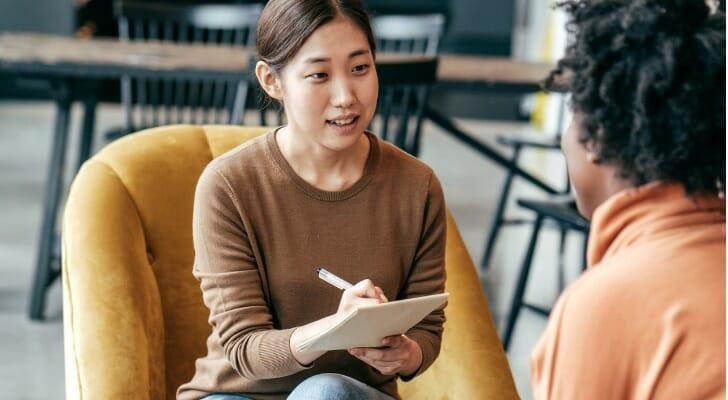Financial advisor discusses income investing with a client