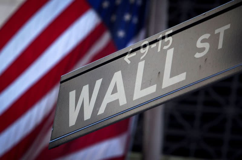FILE PHOTO: A Wall Street sign outside the New York Stock Exchange
