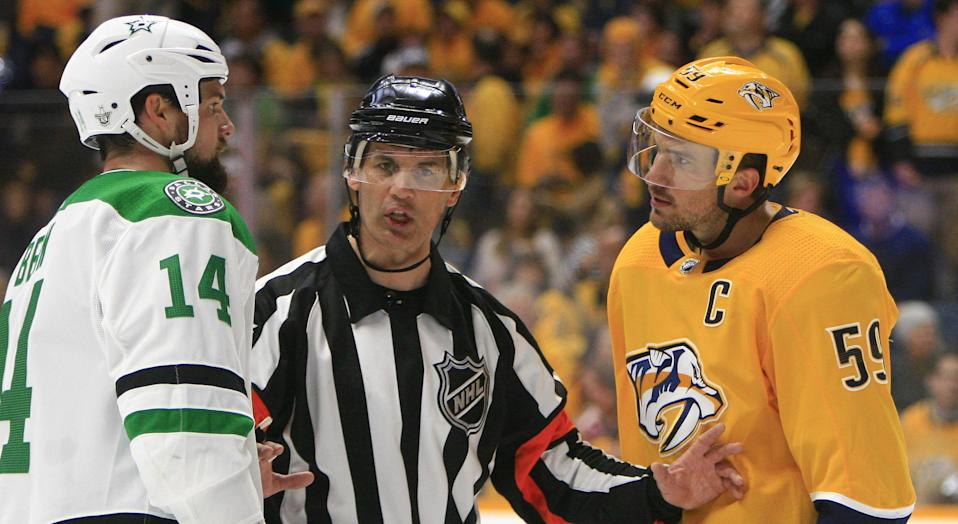 Referee Wes McCauley talks with Dallas' Jamie Benn and Nashville's Roman Josi during Game 5 of their first round matchup on Saturday. (Photo by Danny Murphy/Icon Sportswire via Getty Images)