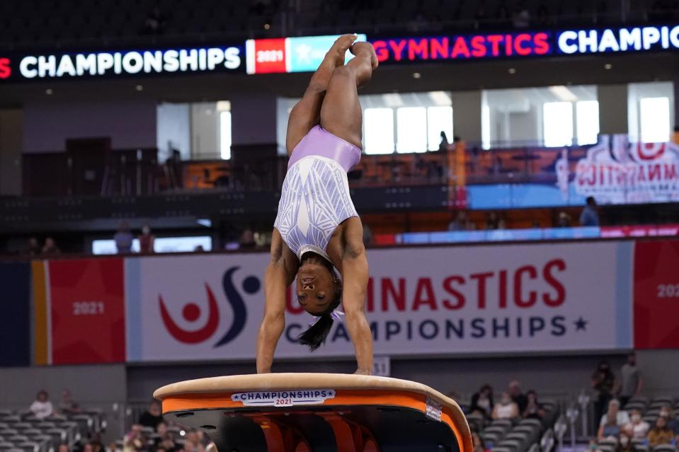 Simone Biles takes a practice run on the vault before the U.S. Gymnastics Championships, Friday, June 4, 2021, in Fort Worth, Texas. (AP Photo/Tony Gutierrez)