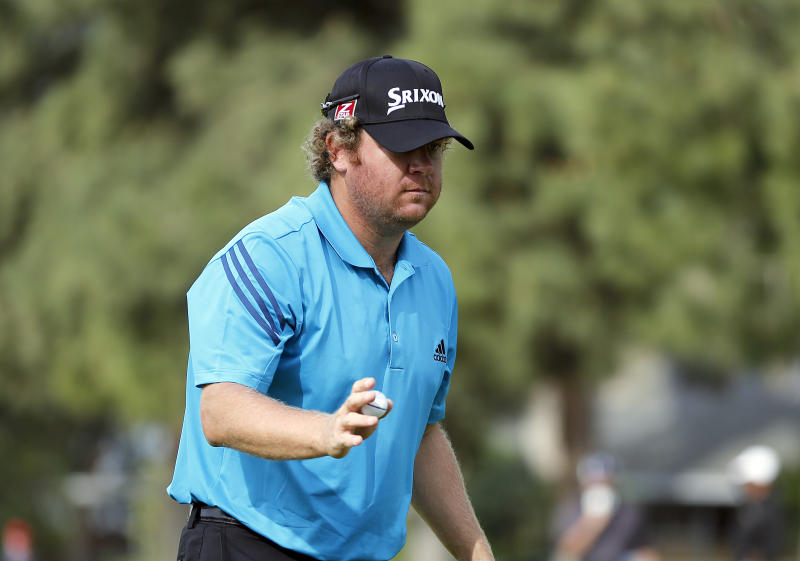 William McGirt reacts after he made birdie on the first hole in the third round of the Northern Trust Open golf tournament at Riviera Country Club in the Pacific Palisades area of Los Angeles, Saturday, Feb. 15, 2014. (AP Photo/Reed Saxon)