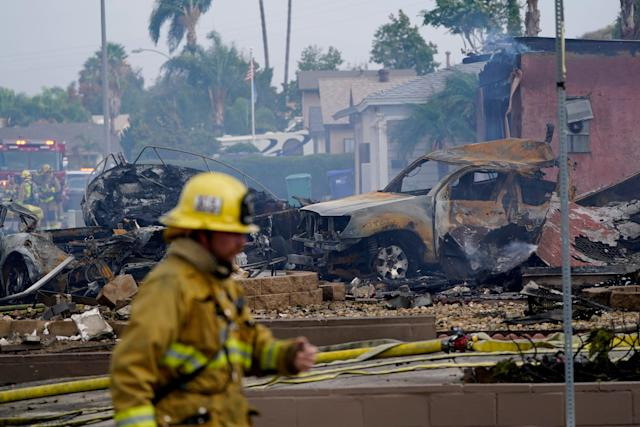 At least 2 dead, including UPS employee, after small plane crashes into  Southern California homes;
