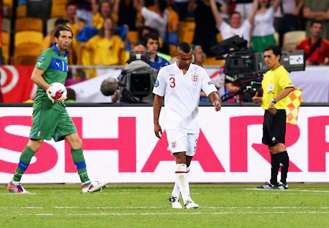 <p>Ashley Cole walks away after his spot kick is saved by Gianluigi Buffon </p>