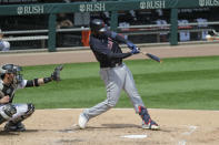 Cleveland Indians' Franmil Reyes hits a two-run home run against the Chicago White Sox during the fourth inning of a baseball game in Chicago, Saturday, Aug. 8, 2020. (AP Photo/Nam Y. Huh)