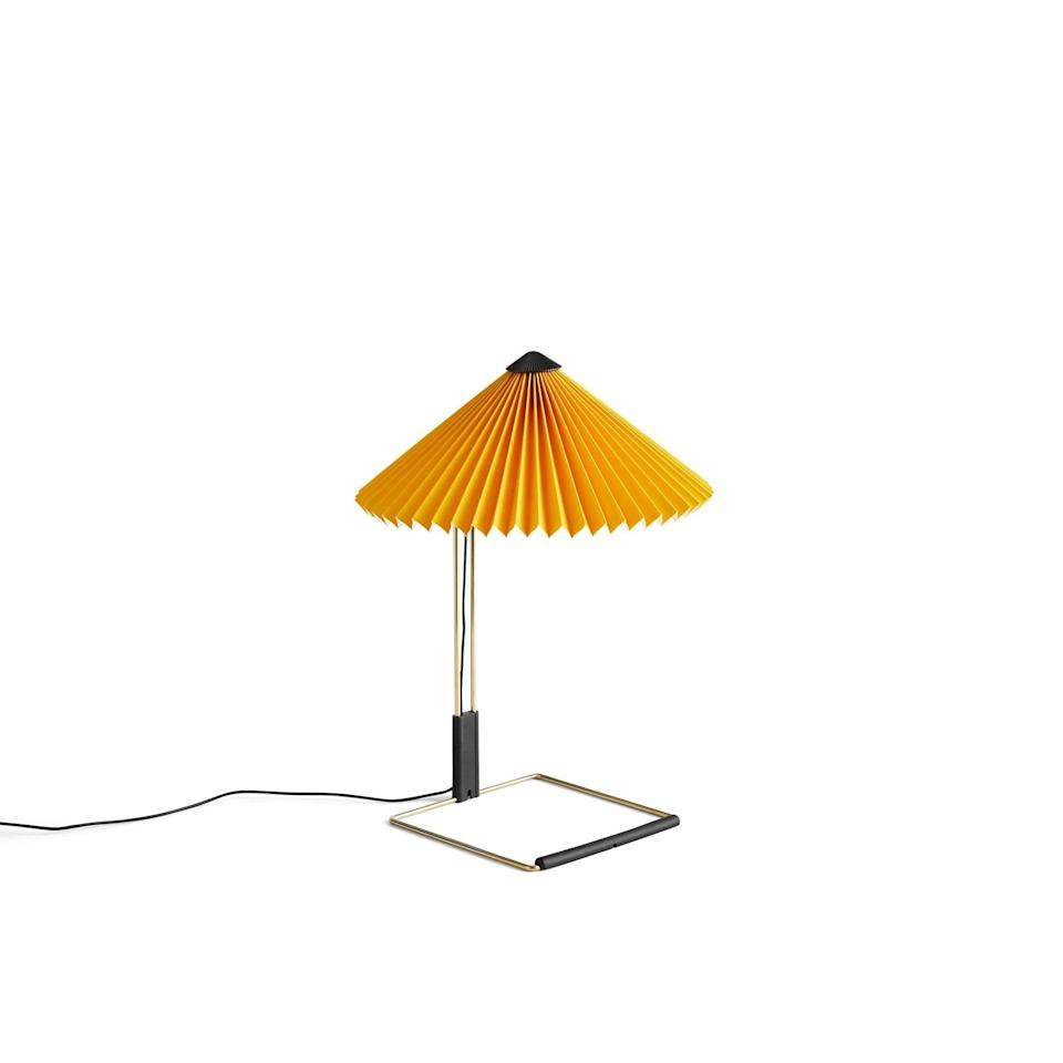 """I moved into a new house last year and for the first time ever I have dark walls in my bedroom. Ever since I've been looking for pieces to brighten up the space and I completely fell in love with this sunshine yellow lamp by Hay. It has a dimmer control so it's perfect for reading in the evenings. <br><br><strong>Hay</strong> Matin Table Lamp, $, available at <a href=""""https://www.skandium.com/products/matin-table-lamp?variant=32019721977959"""" rel=""""nofollow noopener"""" target=""""_blank"""" data-ylk=""""slk:Skandium"""" class=""""link rapid-noclick-resp"""">Skandium</a>"""
