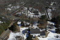 A five-bedroom house, bottom, is seen in Woodbridge, Conn., Wednesday, March 3, 2021. Zoning laws have been under scrutiny for years in Connecticut towns. But the issue has intensified recently, especially in Woodbridge, a New Haven County community of nearly 9,000 with a town center on the National Register of Historic Places. Tim Herbst, a former Republican candidate for governor, is representing a dozen residents opposed to changes proposed by the Open Communities Alliance, an organization founded in 2013 to improve access to affordable housing. (AP Photo/Seth Wenig)