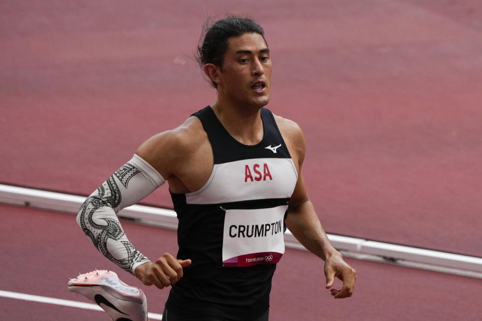 Nathan Crumpton, of American Samoa, competes a heat in the men's 100-meter run at the 2020 Summer Olympics, Saturday, July 31, 2021, in Tokyo. (AP Photo/Charlie Riedel)