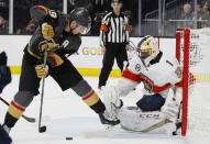 Vegas Golden Knights right wing Reilly Smith (19) scores on Florida Panthers goaltender Roberto Luongo (1) during the second period of an NHL hockey game Thursday, Feb. 28, 2019, in Las Vegas. (AP Photo/John Locher)