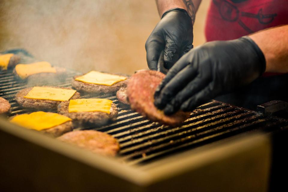 """<p>Grilling can be a dangerous business if you don't follow safe protocols. That's why it's important to make sure your pitmaster is wearing the right attire, including these <a href=""""https://www.amazon.com/Resistant-Ultra-Long-Silicone-Non-Slip-Barbecue/dp/B08R8T627S//ref=as_li_tl?ie=UTF8&amp%3Bcamp=1789&amp%3Bcreative=9325&amp%3BcreativeASIN=B08R8T627S&amp%3BlinkCode=as2&amp%3Btag=thedailymeal-editorial-referral-20&referrer=yahoo&category=beauty_food&include_utm=1&utm_medium=referral&utm_source=yahoo&utm_campaign=feed"""" rel=""""nofollow noopener"""" target=""""_blank"""" data-ylk=""""slk:heat-resistant gloves"""" class=""""link rapid-noclick-resp"""">heat-resistant gloves</a>, which will protect their hands from the heat.</p>"""