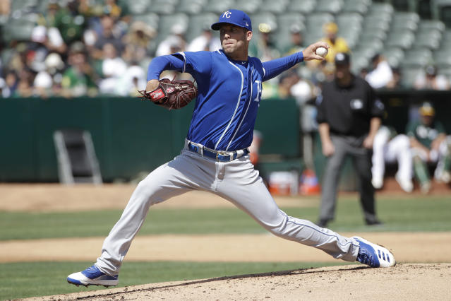 Kansas City Royals pitcher Danny Duffy throws to an Oakland Athletics batter during the second inning of a baseball game in Oakland, Calif., Wednesday, Sept. 18, 2019. (AP Photo/Jeff Chiu)