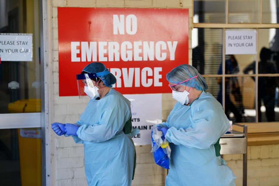 South Australia Hospital staff simulate a drive through coronavirus testing at the Repatriation Hospital in Adelaide. Source: AAP
